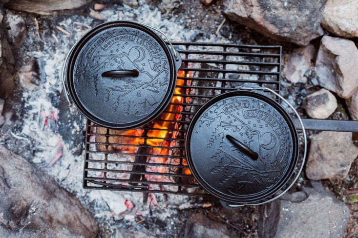 Two Poler Cast Iron Dutch Ovens show the Poler logo on the lids this time.