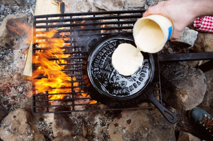 The Enlightenment Skillet flipped over becomes a surface for cooking pancakes.