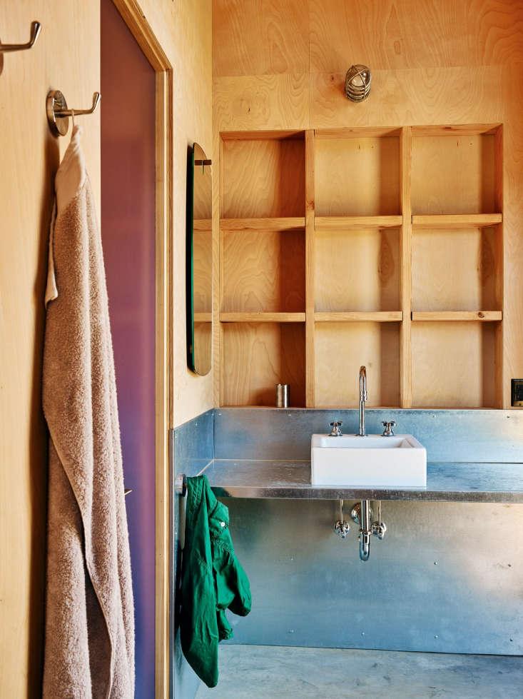 pool house bathroom metal siding plywood cubbies