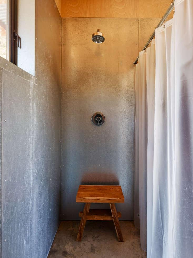 pool house shower metal walls wood stool malcolm davis