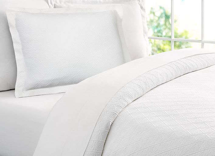 Pottery Barn offers a range of Portuguese Reeve Matelasse organic bedding; the full/queen Reeve Duvet Cover is $9 and the Reeve Sham is $49.50.