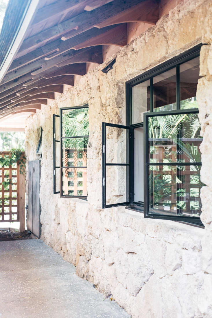 the exterior has a traditional roof; new, low profile aluminum casement windows 10