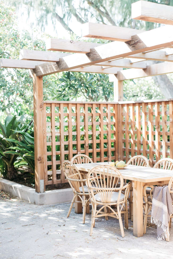 outside, apergola creates privacy and an outdoor dining space, caned chairs i 26