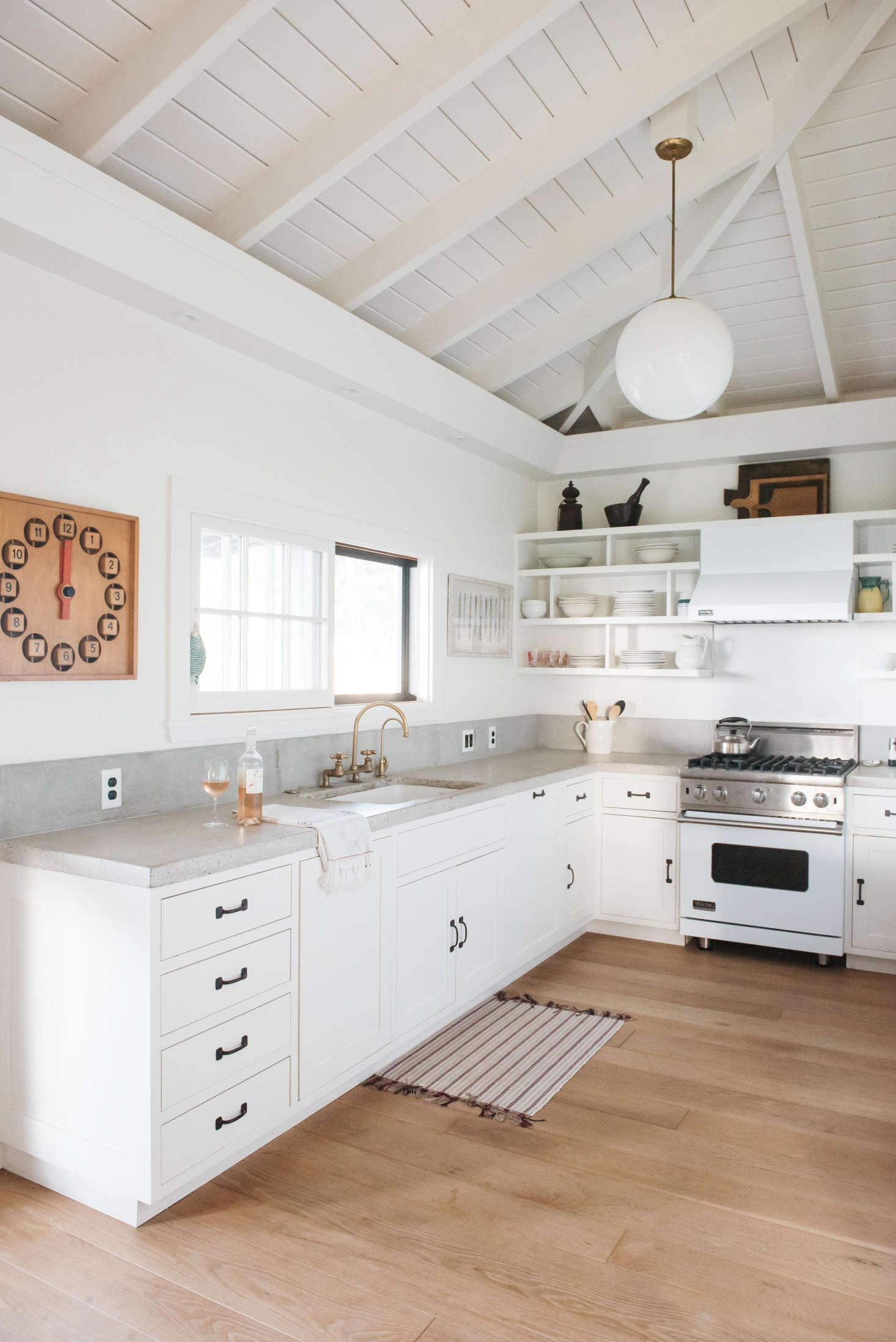 A Viking range fits with the white color scheme inA Vintage Hawaiian Cottage Restored (with Its Own Instagram Account).