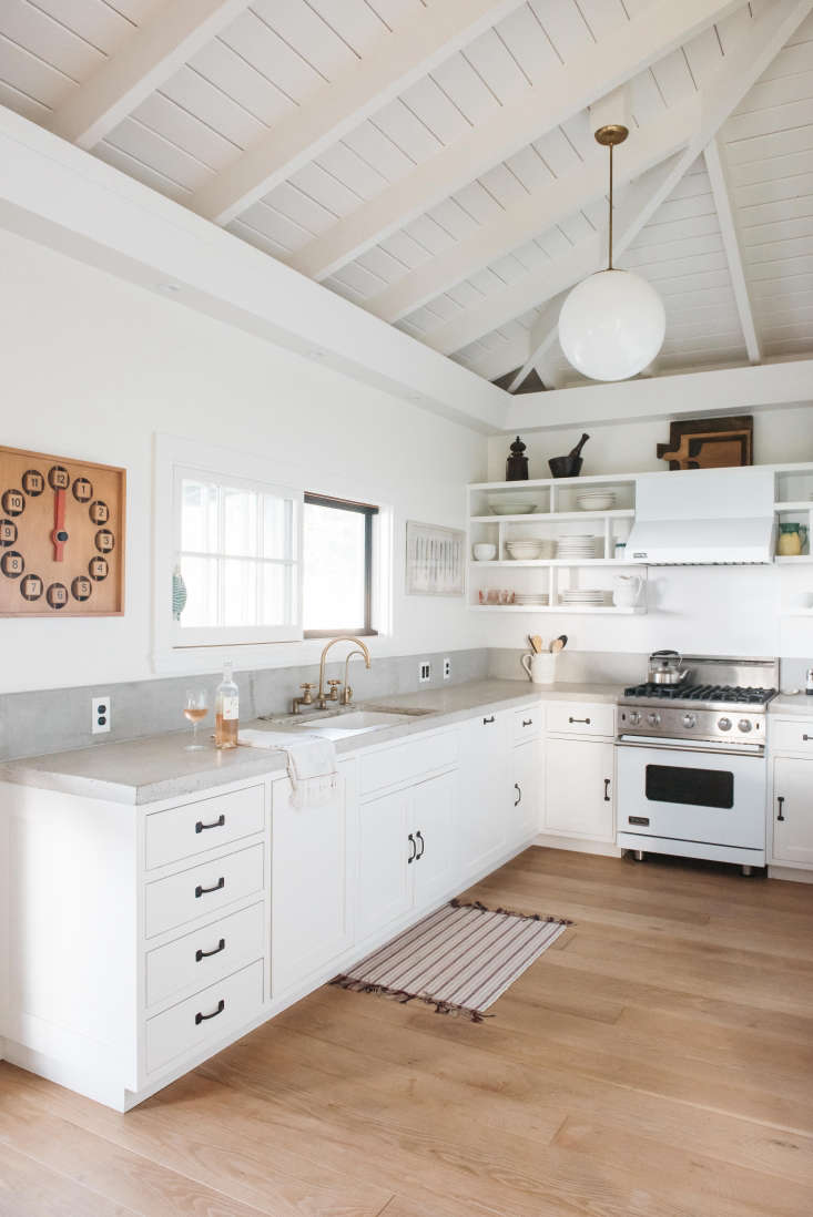 a viking range fits with the white color scheme ina vintage hawaiian cottage  15