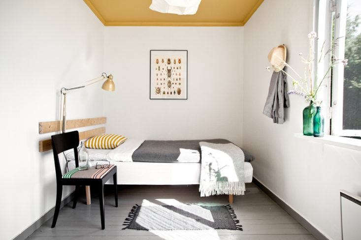 Add a dash of summery yellow:In this airybedroom at the Sågverket Möten Rum & Kök in northern Sweden, the ceiling is painted marigold yellow.