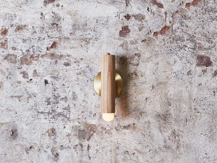 The Lodge Sconce, the most basic form in the new Lodge collection, is a single turned-wood rod mounted on a metal backplate; $750.