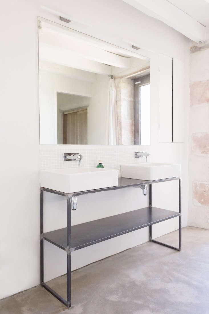 in the bathroom, double sinks stand on a welded steel customvanity. the metri 17