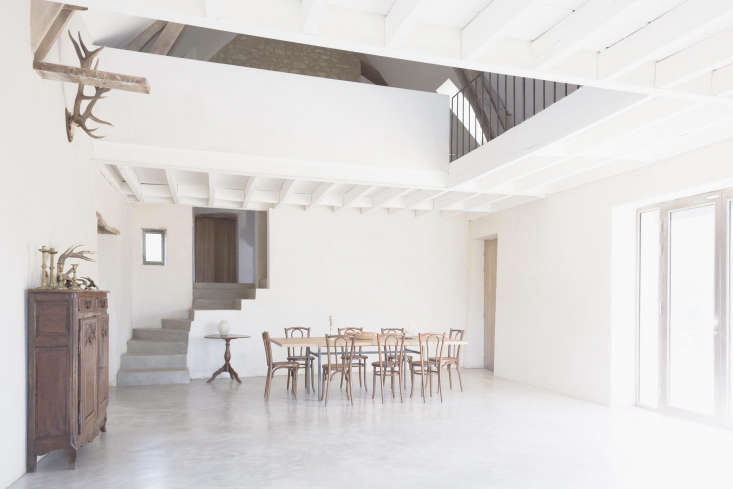 A sparse and simple dining room in a bright farmhouse by Septembre Architecture. For more, see A Stone Farmhouse in France Gets an Artful Update from a Paris Firm. Photograph by Linus Ricard, courtesy of Septembre Architecture.