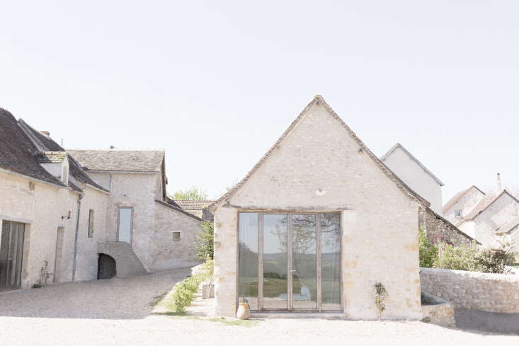 the farmhouse sits comfortably in the context of its surrounding village. 19