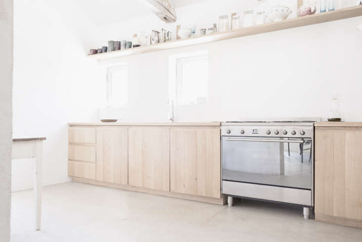 in the kitchen, new materials are introduced through the light wood cabinets, o 9