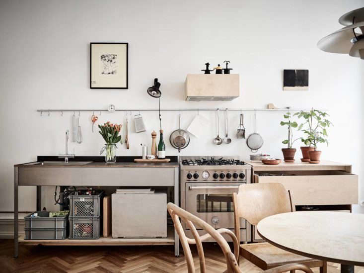 A kitchen by Swedish designersStadshem includes a stainless steel restaurant cart, Bertazzoni range, and plywood drawers. See more in Steal This Look: Smart Storage in a Swedish Kitchen.