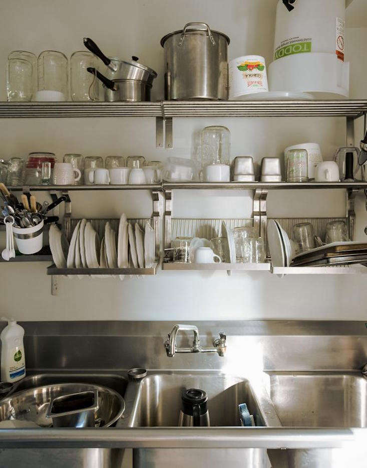 Ultimate Budget Storage 10 Kitchens with Ikeas Grundtal Rail System A full Grundtal setup at Table on Ten cafe consists of wall shelves, dish drainers, and hanging containers. Photograph by Matthew Williams fromOld Is New: Table on Ten in Upstate New York.