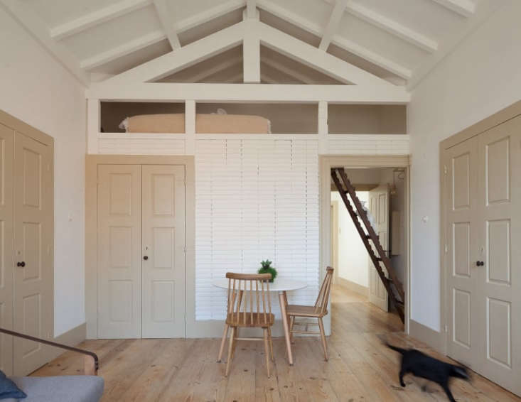 tan white guest house in portugal wood floors