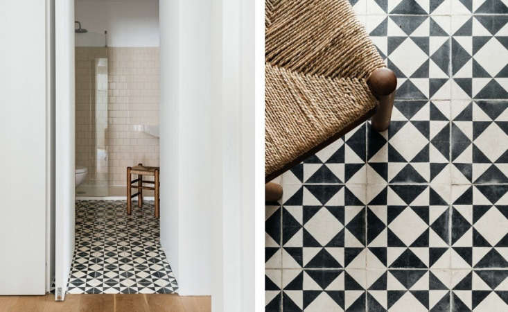 A peek into a bathroom with a black-and-white tiled floor.