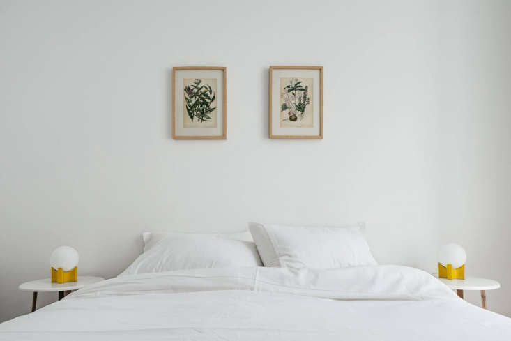 The Lisboans has  apartment-style guest suites. Shown here: the Comfort One-Bedroom, vintage botanical prints included. (For a similar look, see Steal This Look: A Portuguese Bedroom with Vintage Charm.)