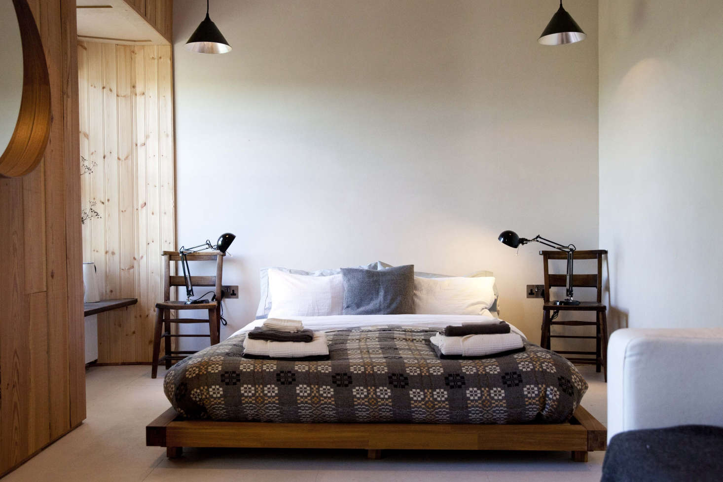 Old-school, patterned wool blankets are making a comeback, as in this bed in a Welsh country inn. See more in FForest: A Former Farm Transformed into the Ultimate Welsh Country Retreat, as well as Trend Alert: The Return of the Patterned Wool Blanket.