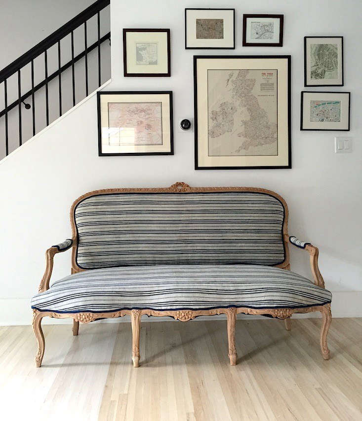 Izabella refreshed a dated, gilded settee from a local estate salewith the help of several yards ofstriped linen fabric. See Before & After: Izabella's Reinvented Settee, Vintage Scandinavian Fabric Included.