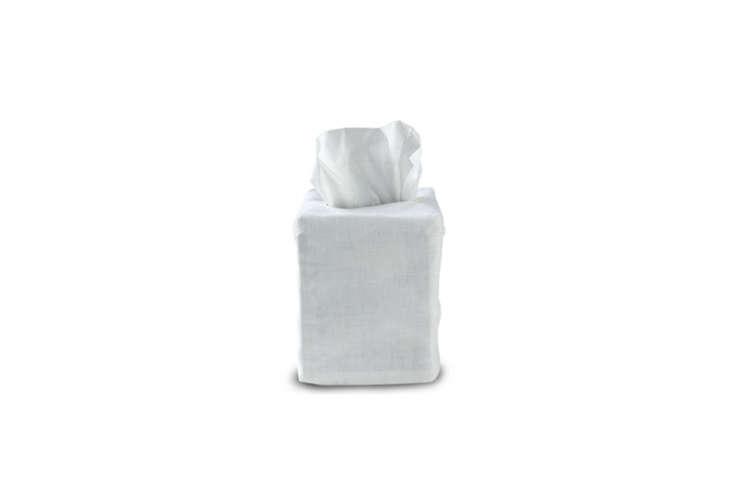 the waterworks classic linen tissue cover box is made ofsheer white linen; \$ 10