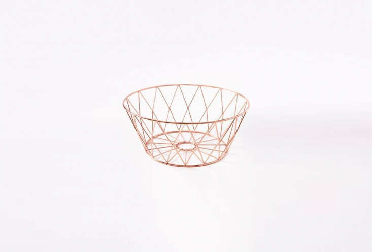the copper wire kitchen fruit bowl is \$\23 from west elm. 24