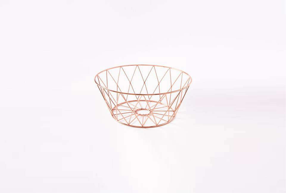 The Copper Wire Kitchen Fruit Bowl is $ from West Elm.