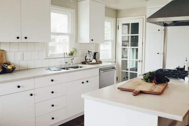 white kitchen black knobs seattle square tile backsplash