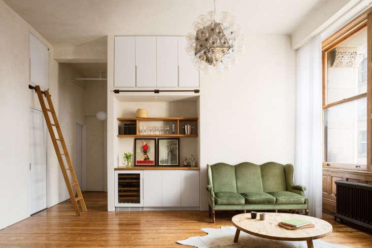 white kitchen loft bubble chandelier wood floors 1