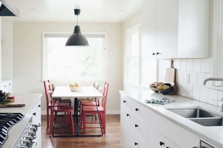 white seattle kitchen with wood floors red chairs
