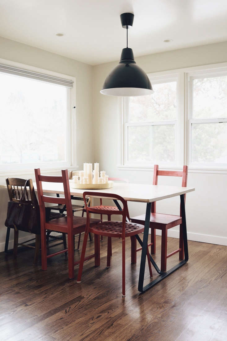 wood dining table red chairs seattle kitchen black pendant light