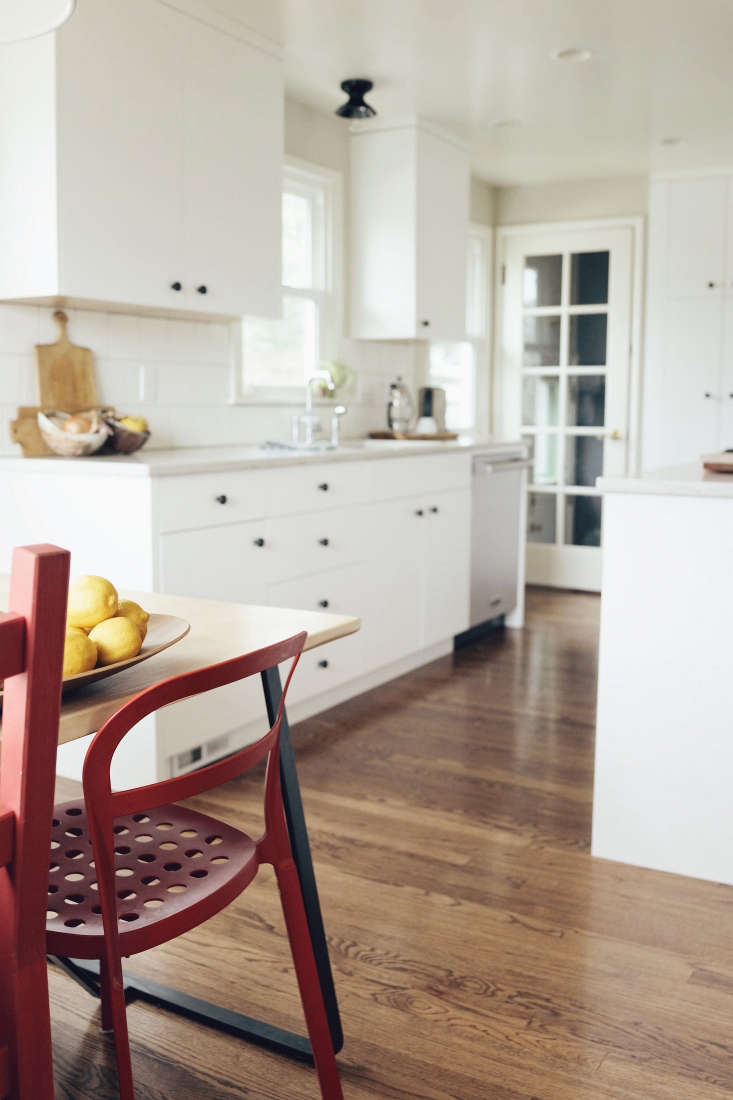 wood floors white kitchen seattle red chairs