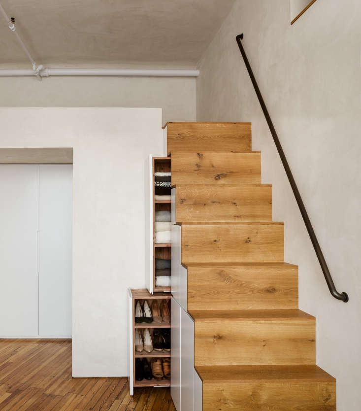 the custom slide out closet built into the staircase is just one of the storage 10