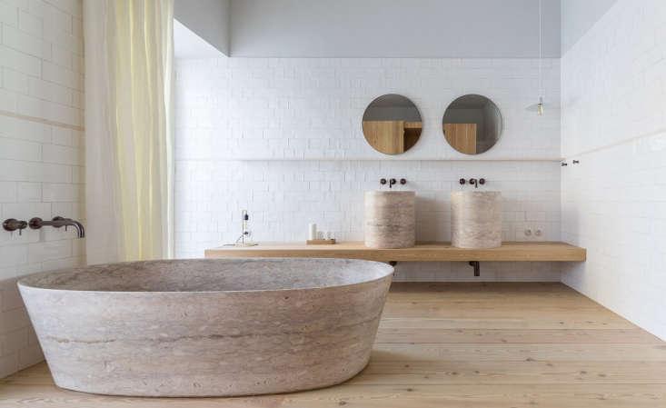bathroom marble bathtub twin sinks round mirrors santa clara hotel portugal