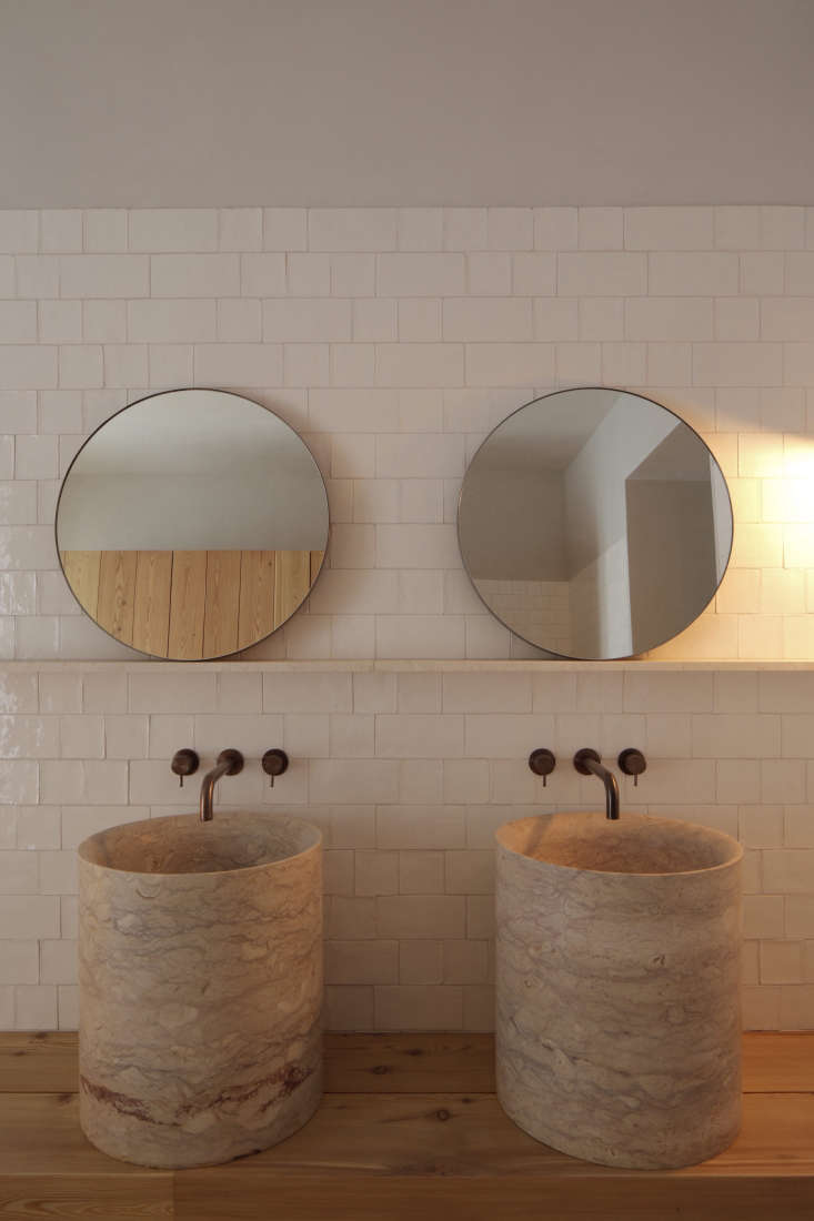 bathroom twin sinks round mirrors santa clara hotel portugal