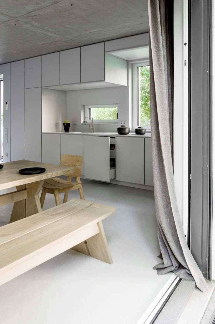 Like all of the doors and drawers in the house, the kitchen cabinets and fridge have hidden touch-latch handles that open with a push.