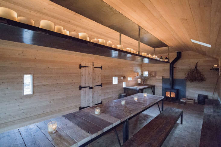 Dinner on the Moors A Rustic OfftheGrid Cottage in the Scottish Highlands The structure consists of onelarge, sparseroom, where an elongated wood table is the centerpiece.