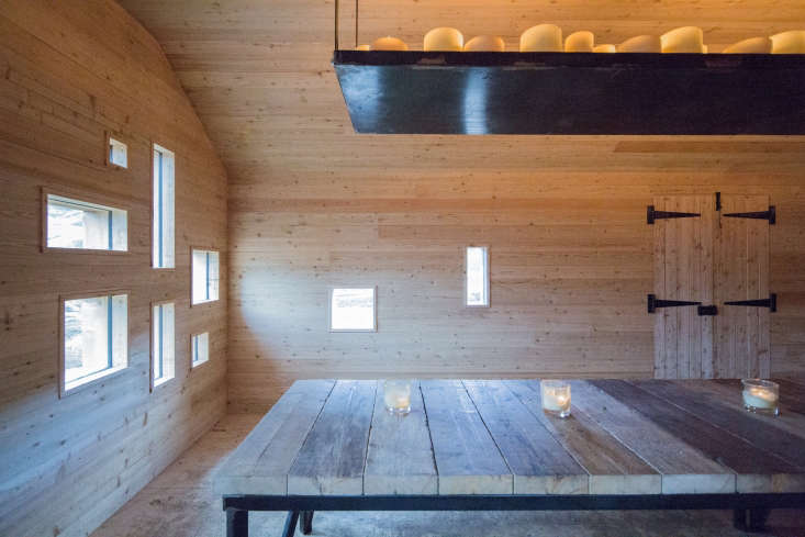 Dinner on the Moors A Rustic OfftheGrid Cottage in the Scottish Highlands Rectangular windows cut into the wood are inspired by Le Corbusier&#8\2\17;s iconicRonchampchapel in France. The shelf also holds crookery and dishes.
