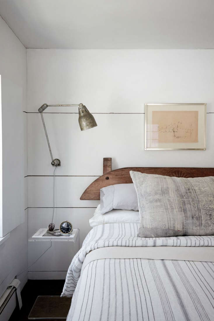 The 00s Dutch headboard is from Red Chair in Hudson and the bedside lamp was found atBrimfield. The pillow is a custom design made with vintage fabric; for something similar, see Diani Living&#8