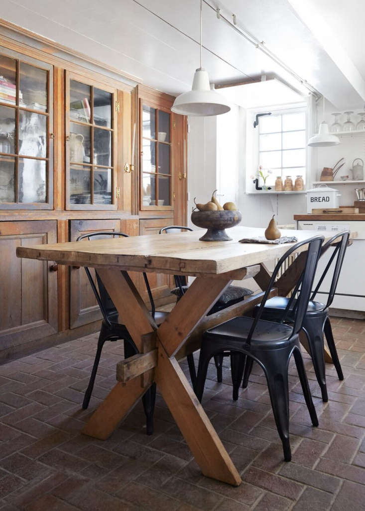 The kitchen is located in a 50s-era addition off the main house; the antique Swedish dining table is from Red Chairand the Tolix-style chairs are fromHammertown in Rhinebeck. &#8