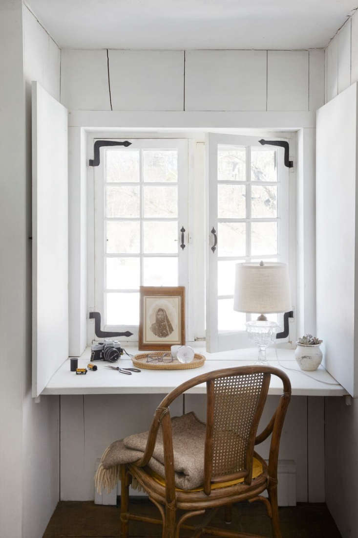 the upstairs bedroom in a \1700s farmhouse has a built in desk cleverly slotted 23