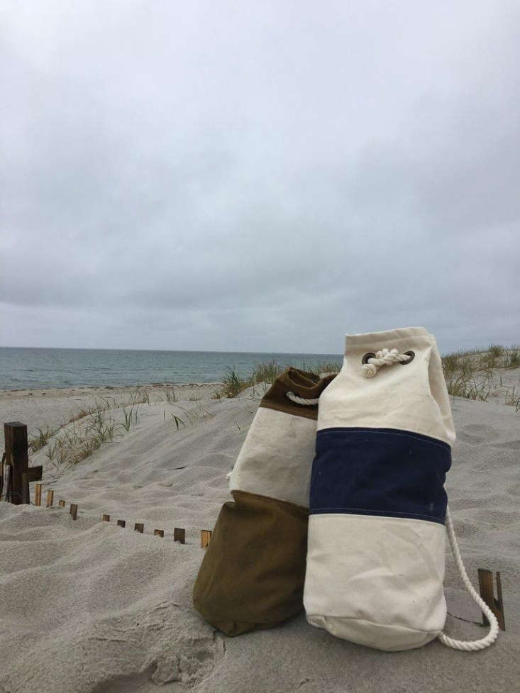 Featuringdesigns inspired by aNew England icon: the lobster buoy, each duffle is madefrom salvaged heavy-duty canvas and finished with brass grommets and cotton ties.