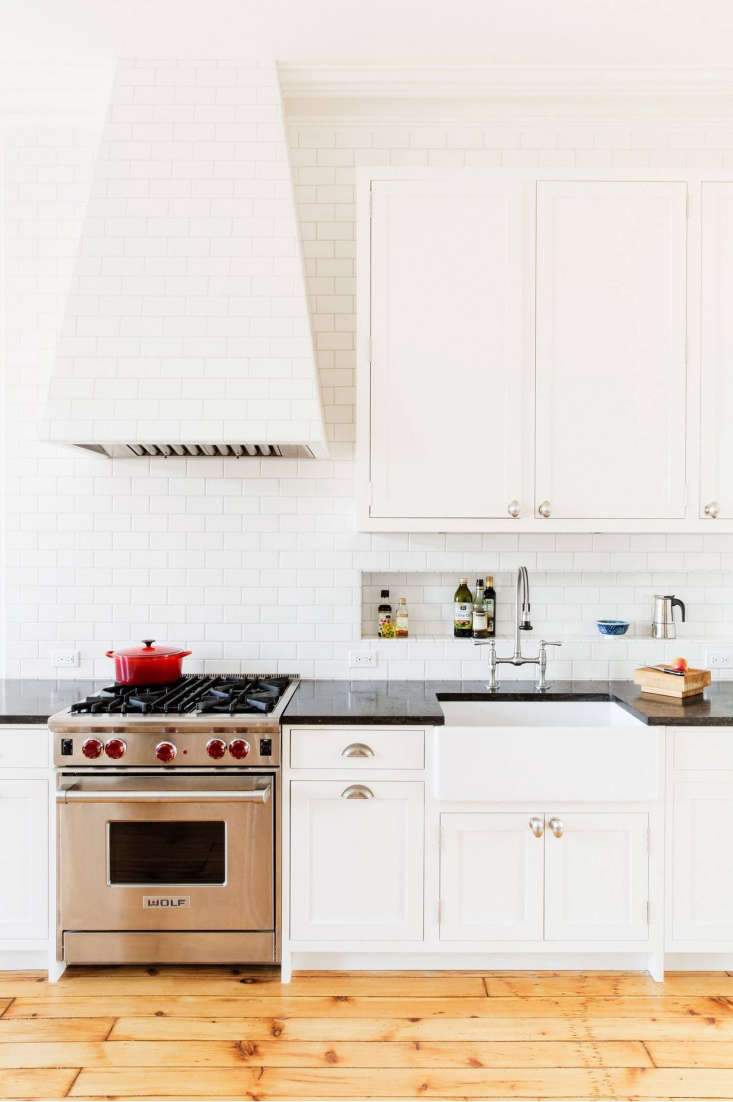 In a kitchen in Carroll Gardens, Brooklyn, Elizabeth Roberts (a member of the Remodelista Architect & Designer Directory) tiled the range hood and inserted a tiled storage niche above a countertop.