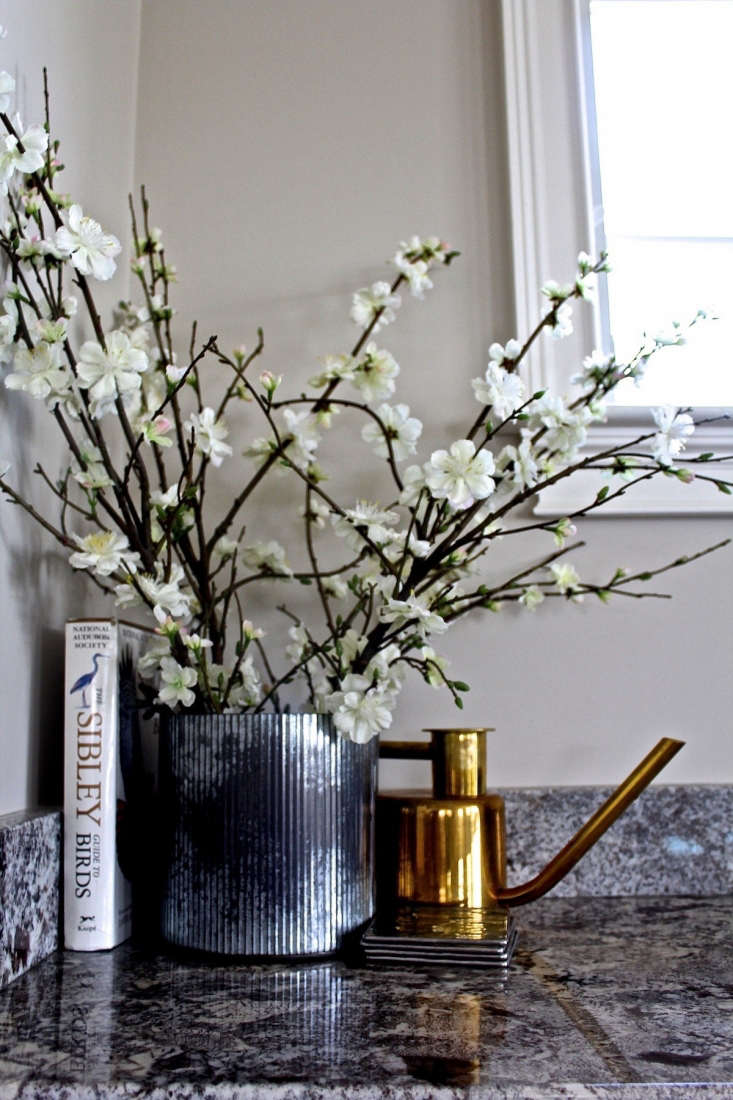 flowers watering can vignette from considered design awards