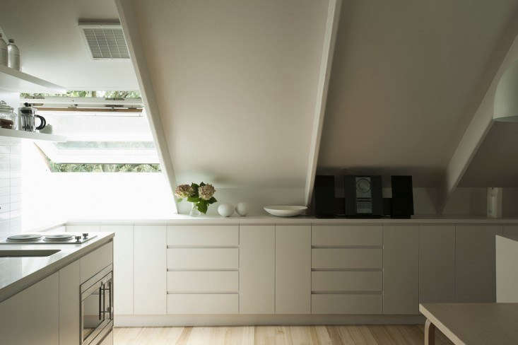When it comes to kitchenettes, practice smart storage: In the same garage apartment, low, built-in storage cupboards conceal tableware and food items (and don&#8