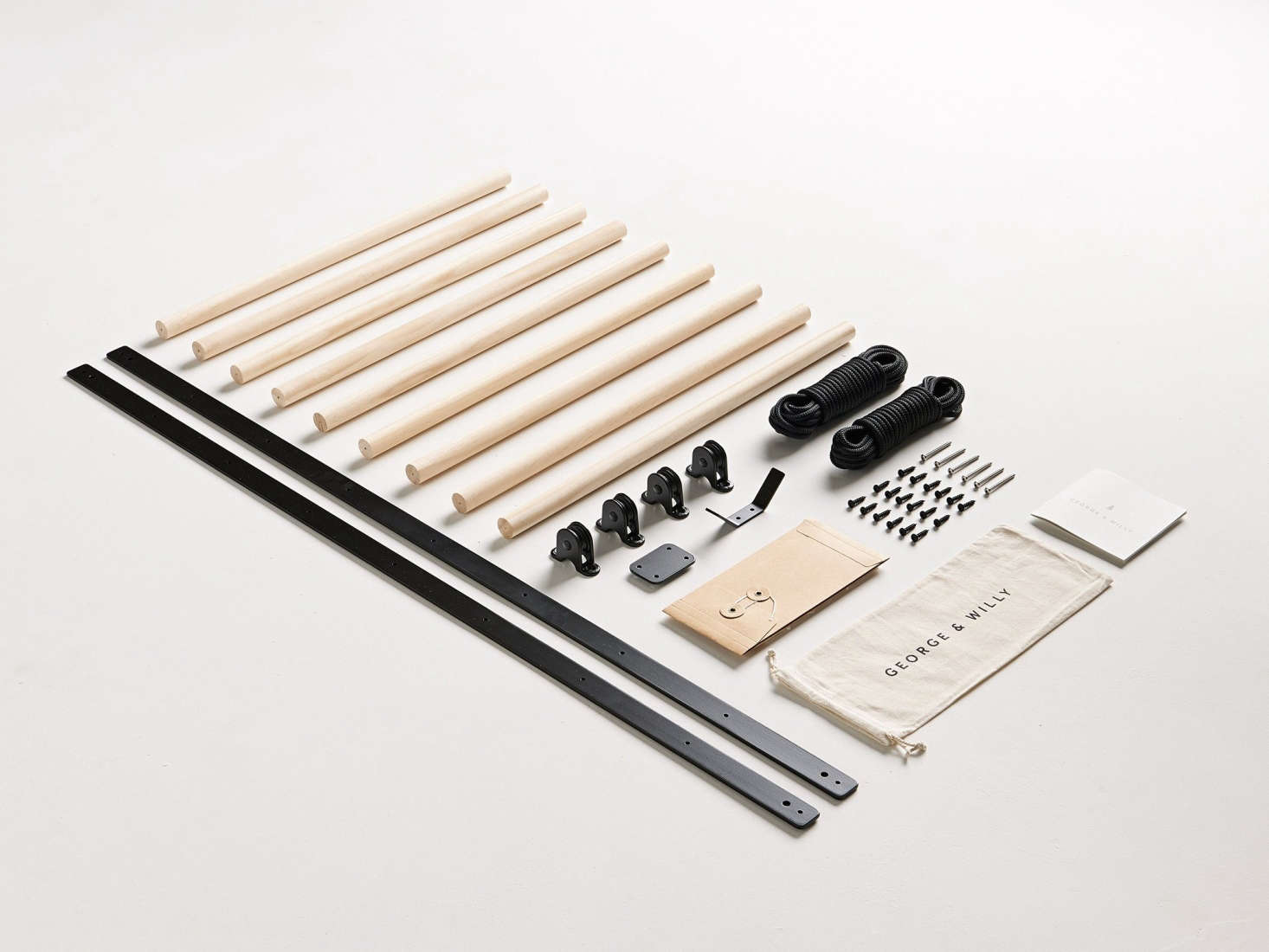 The rack comes disassembled and is available in black or white.