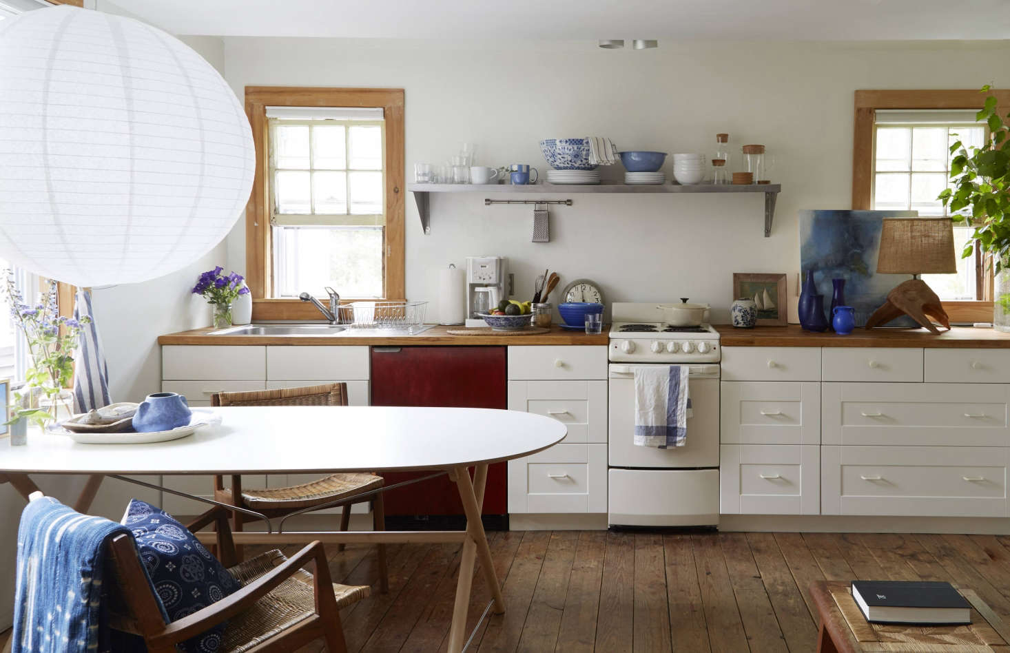 Ikea kitchen cabinets, doors, and countertops in a remodeled beach cottage in Provincetown by designer Glenn Ban. For more, seeA Beach Cottage in Provincetown, Styled for Budget-Minded Summer Living.