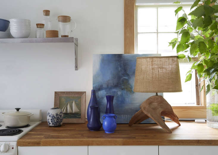 The vintage midcentury Danish and Germanpottery vases arefrom Ruby Beets. The James Keating work on the left was a gift, and the abstract work on the right is by Jen Bradley from theSchoolhouse Gallery in Provincetown.