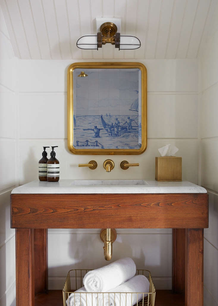 Greydon House A Seafarers Inn with Maritime Finds on Old Nantucket Showers are lined in maritime scenes made of Portuguese tiles, and sconces on the eaves have an air of recycled industrial corridor lights. The boxy and unpainted sink vanities, reminiscent of \19th century farmhouse washstands, leave glossy pipes exposed.