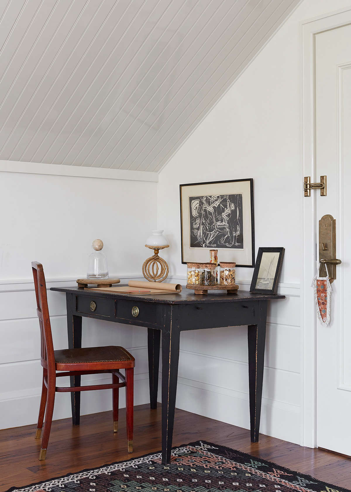 At Greydon House on Nantucket, paneling along the wall, as well as beadboard on the ceiling, create a greater sense of height in the Broad Suite. See Greydon House: A Seafarer's Inn (with Maritime Finds) on Old Nantucket.