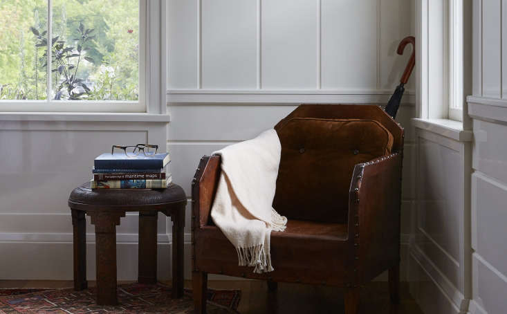Greydon House A Seafarers Inn with Maritime Finds on Old Nantucket An armchair with chamfered corners has a sense of central European sturdiness, alongside a side table with ziggurat motifs that hint at Persian origins.