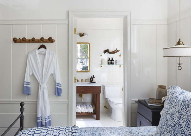 Greydon House A Seafarers Inn with Maritime Finds on Old Nantucket Oversize hanging pegs resemble sturdy nautical knobs, a ceramic spice jar on a nightstand gives a whiff of far flung trade routes, and a driftwood fragment does not overwhelm a bathroom shelf.